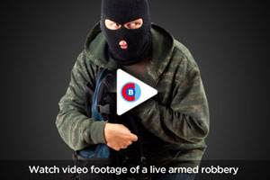 Watch video footage of a live armed robbery